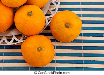 tangerines on the tablecloth