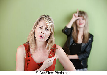 Frustrated Mother - Frustrated woman points at girl showing...