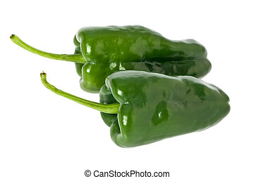 Poblano Peppers - Two whole green poblano peppers against a...