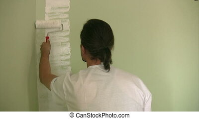 Painter painting the wall