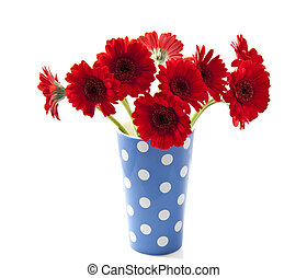 Red gerbera - Bouquet gerbera's in blue white spotted vase...