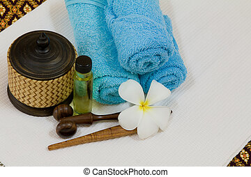 Health spa with white flower ,bottles with essential oil