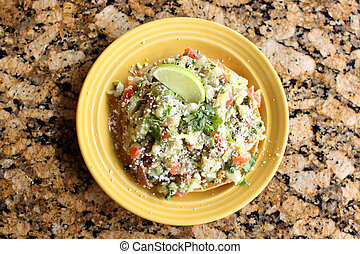 Delicious tostada ceviche with rockfish on a plate.