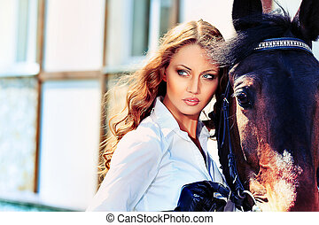 horse - Beautiful young woman with a horse outdoor.