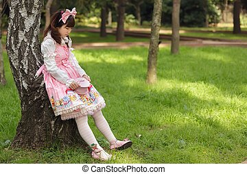 sad lolita - sad japanese woman in sweet lolita cosplay,...