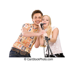 Attractive young couple singing