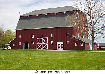 Red Barn - A photo of a red barn with green grass