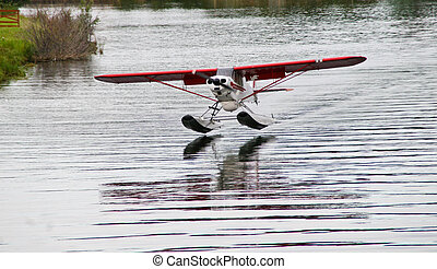 Float Plane - Photo of a float plane landing on an Alaskan...
