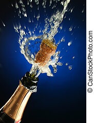 Champagne bottle ready for celebration - Champagne splash....
