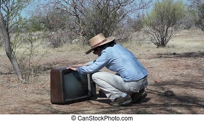 Woman out in the Boonies with TV - Woman getting frustrated...