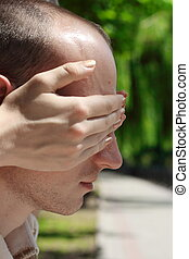 Guess who? - Girl covering a guy eyes to see if he can guess...