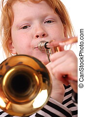 Trombone player - Young girl playing a trombone on white...