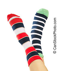 Colorful socks - Child legs in colorful striped socks on...