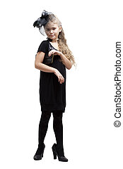 Playing Dress-up - Eight years old girl in her mother's...