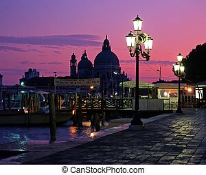Quayside at sunset, Venice, Italy. - Quayside and church of...