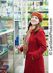 Woman  in pharmacy drugstore