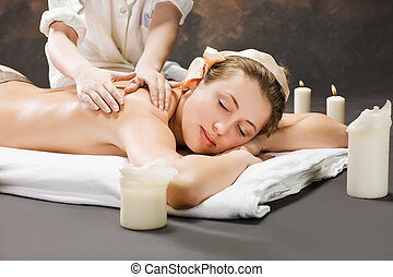 A beautiful woman getting a massage