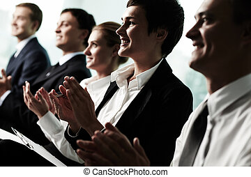 Successful speech - Tilt up of roup of business people...
