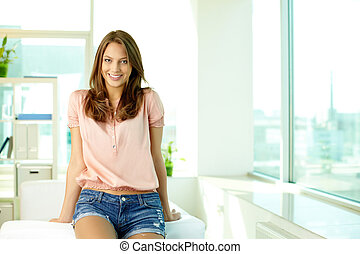Sweet girl - Smiling girl with a flirting look sitting on...