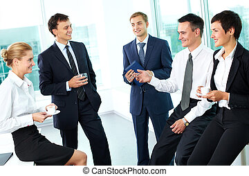 Business ties - Business people interacting with each other...