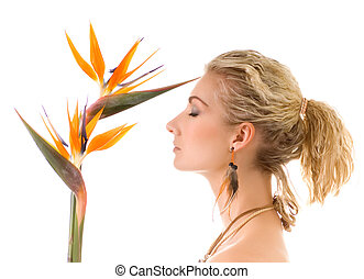 Beautiful woman with bird of paradise flower isolated on...