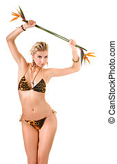 Beautiful woman dancing with bird of paradise flower...