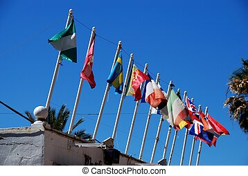 Row of flagpoles, Fuengirola - Row of flags on beach bar...