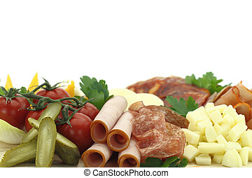 Meat delicatessen plate with cheese