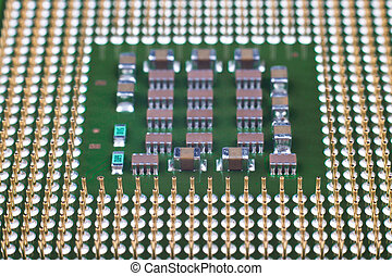 Microprocessor gold pins close-up with smd components
