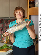 Mature woman with fish
