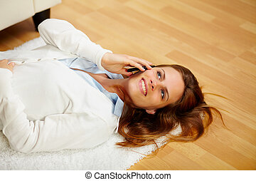 Lovely woman making a call on the cell phone - Portrait of a...
