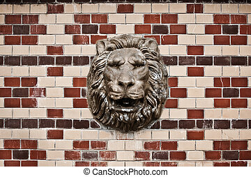 Lion head - Shot of statue of a lion head int the wall