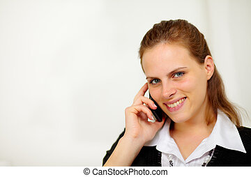Young beautiful businesswoman at cellphone - Close up...