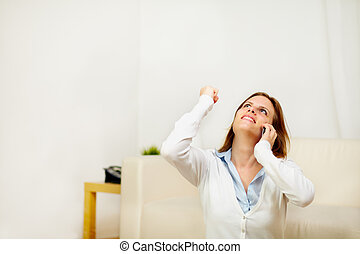 Girl on mobile phone celebrating a victory - Portrait of a...