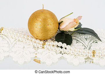 bridal rose and golden candle