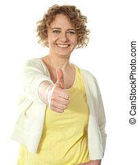 Glamorous woman gesturing thumbs-up