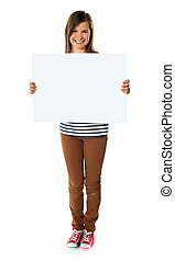 Smiling girl holding empty white board isolated over white