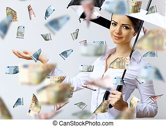 Business woman under money rain with umbrella - Collage with...