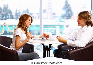 Young couple having a date in restaurant - Young couple in...