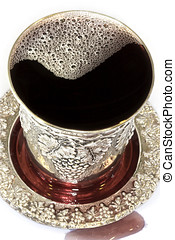 Fancy silver kiddush cup - Silver cup overflowing with...