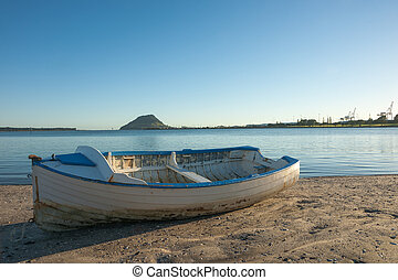Dinghy boat. - Dinghy sits on beach, Mount Maunganui on...