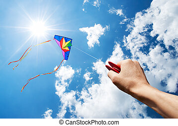 flying kite - kite flying in a beautiful sky with sun and...