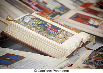 Old style book with medieval paintings during a fair