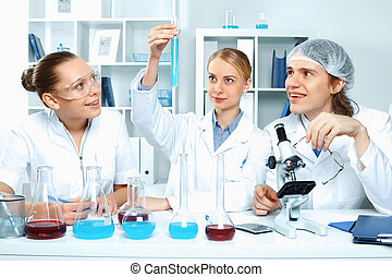 Young scientists working in laboratory