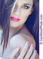 woman with long hair an pink make-up - portrait of a...