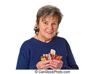 Female senior with pills