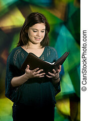 God's Word in God's House - A young teen smiling as she...