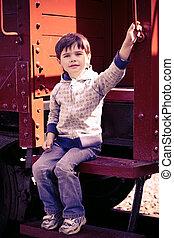 boy and an old train - 3-year-old boy near a retro car in a...
