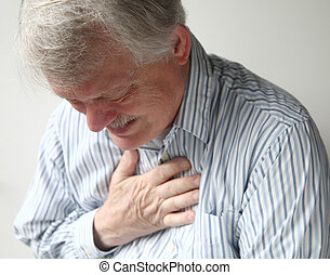 man with severe chest pain - a senior man suffering from bad...