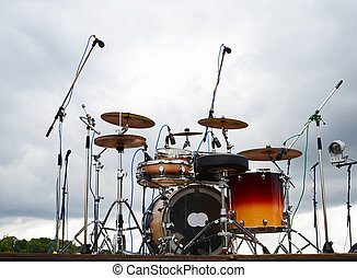 Drums on a stage in a park